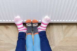 Feet by the heater